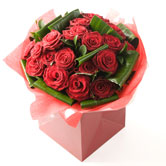 An Arrangement of 24 Luxury Red Roses