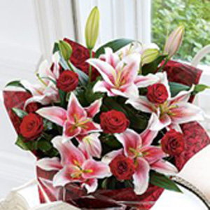 Oriental Lilies & Rose Hand-tie with Teddy Bear and Heart Chocolates