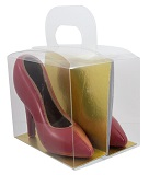 Pair of red coloured milk chocolate mini shoes in transparent handbag