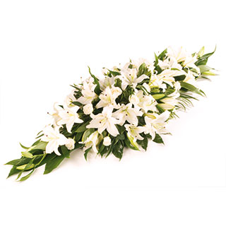 White lilly flowers arranged in funeral casket spray delivered in the uk white casket funeral spray mightylinksfo