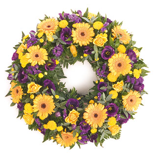 Yellow and Blue Funeral Wreath of Bright Flowers