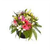 Flower arrangement of pink lilies,roses,gerberas and foliage,deliver flowers from The Harvest Garden